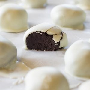 Oreo Truffles - These Oreo Truffles are one of my favorite recipes of all time! Cream cheese and crushed Oreos dipped in almond bark.