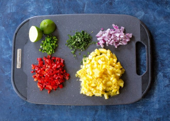 Ingredients for pineapple salsa on a cutting board