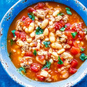 This White Bean and Sausage Soup is from my friend Steph only has six ingredients and has spicy sausage, basil, tomatoes, and beans!