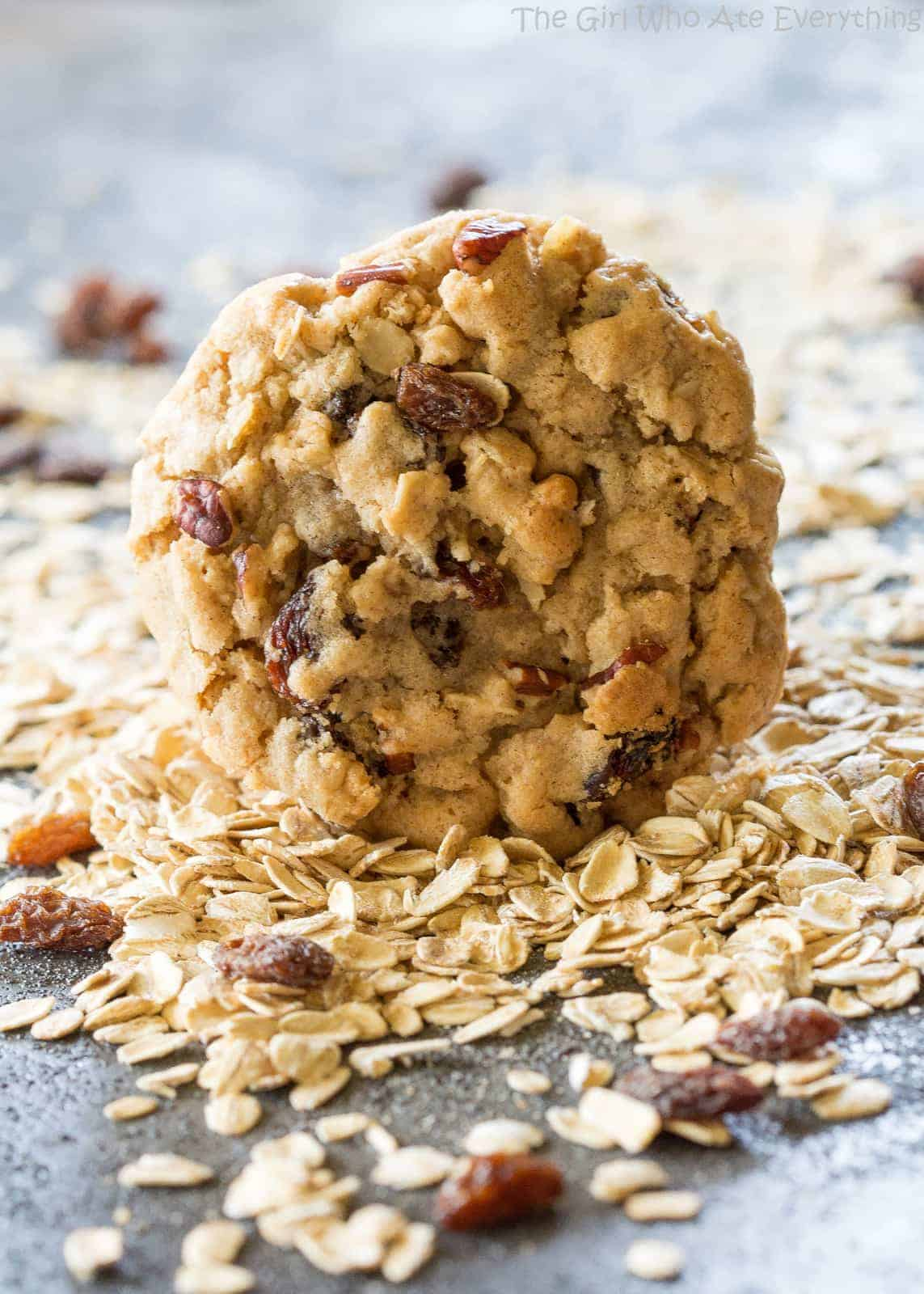 Chewy Oatmeal Raisin Cookie in a pile of oats and raisins