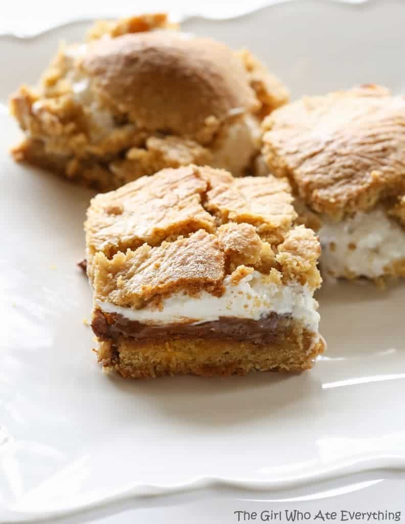 S'mores Bars - layers of graham cracker dough, marshmallow, and gooey chocolate. the-girl-who-ate-everything.com