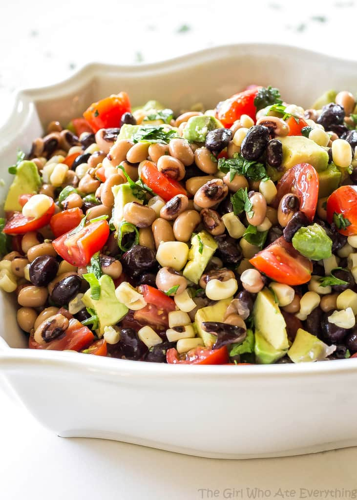 Cowboy Caviar - One of our favorite sides to bring to a potluck. Eat with chips or just a fork! the-girl-who-ate-everything.com
