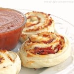 Pizza Rolls - your favorite pizza toppings rolled up in dough and dipped in pizza sauce. the-girl-who-at-everything.com