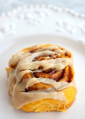 Pumpkin Cinnamon Rolls With Caramel Frosting - pumpkin spiced cinnamon rolls with a sweet caramel icing. the-girl-who-ate-everything.com
