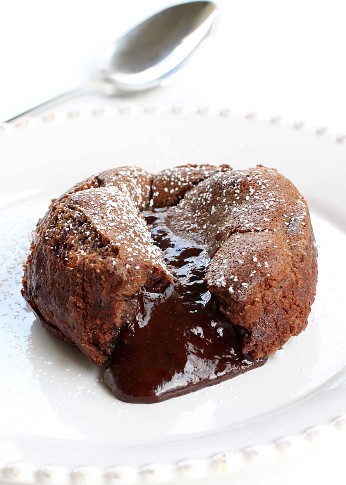 Roy's Chocolate Souffle (Molten Lava Cakes) - a gooey chocolate center is a surprise in the middle! A chocolate lover's dream. Not a copycat recipe. The actual recipe from Roy's. the-girl-who-ate-everything.com