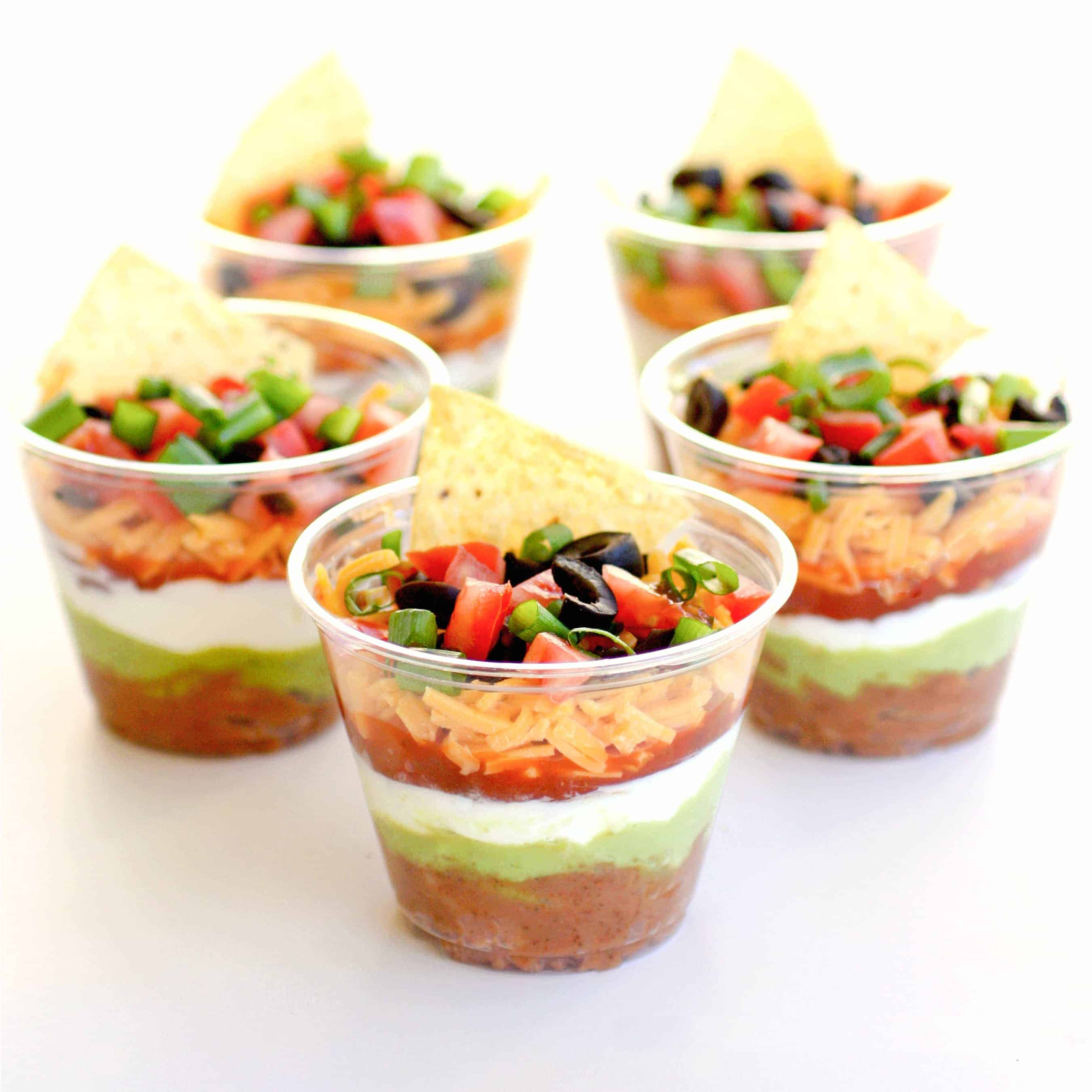 seven-layer dips snacks | DIY Beach Party Ideas For Your Beach-Themed Celebration