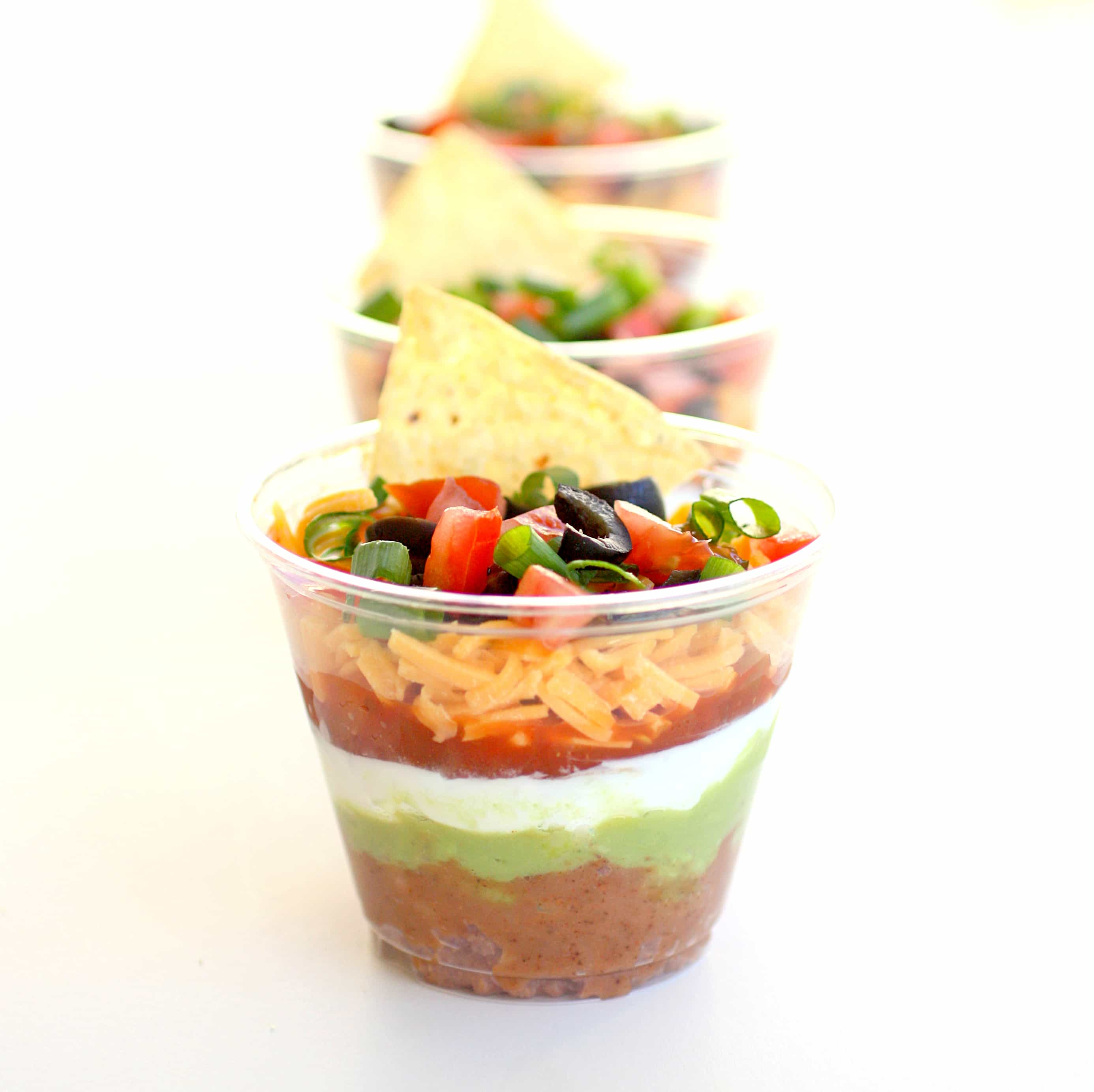 These Individual Seven-Layer Dips are individually portioned dips ...