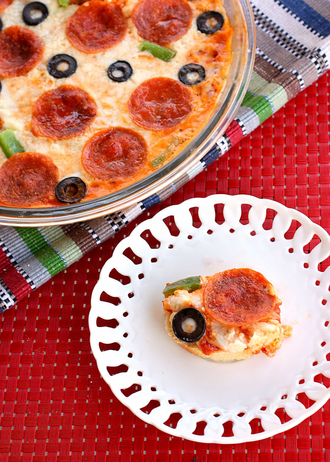 Hot Pizza Dip - seriously addicting and an appetizer everyone will love. the-girl-who-ate-everything.com