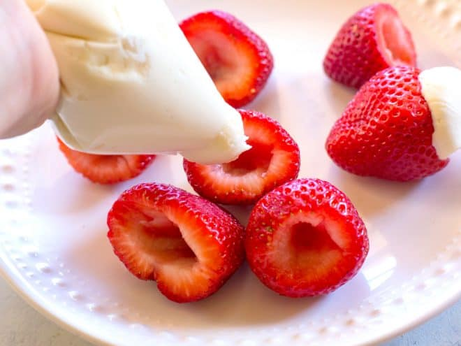 hollowed out strawberries with cream