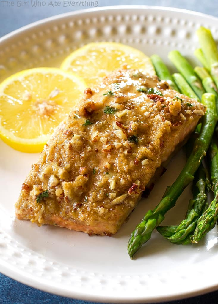 Baked Dijon Salmon - salmon topped with honey, dijon mustard, pecans, and breadcrumbs. An easy weeknight dinner. the-girl-who-ate-everything.com