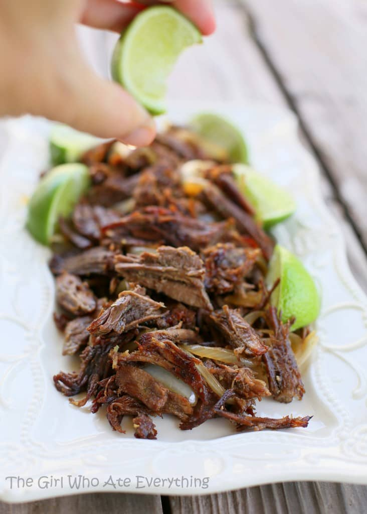 This Vaca Frita is Cuban Shredded Beef  that is moist, tender, and crispy on the outside. It's infused with orange and lime juice for a mojo flavor. the-girl-who-ate-everything.com
