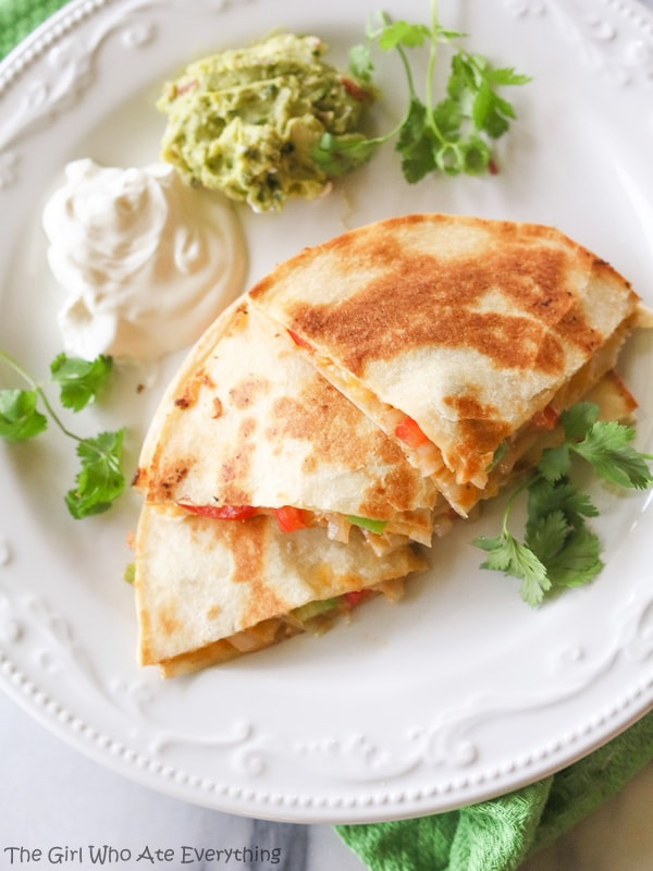 Fajita Quesadillas - Tortillas are filled with seasoned veggies and lots of cheese. A quick dinner for any night of the week. {The Girl Who Ate Everything}