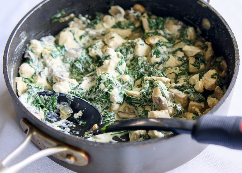 Chicken, Spinach, and Mushroom Enchiladas - creamy enchiladas topped with a cilantro sour cream sauce. This dish is company worthy. the-girl-who-ate-everything.com