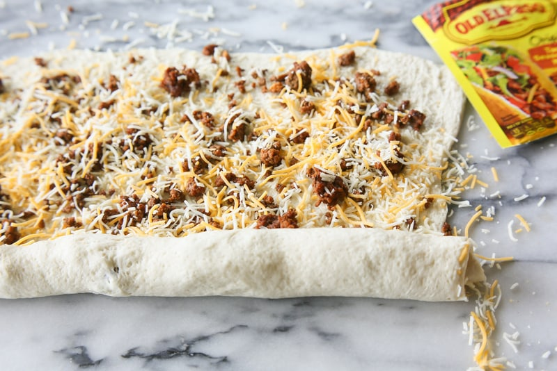Taco Pizza Rolls - taco meat and cheese rolled up in pizza dough and topped with your favorite taco toppings. the-girl-who-ate-everything.com