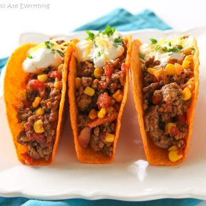 These Texas Tacos are a Tex-Mex twist on your classic taco. It's filled with taco meat, bell peppers, onions, diced tomatoes, and corn. the-girl-who-ate-everything.com