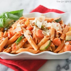 Creamy Pasta Primavera - penne pasta with vegetables and covered with a creamy pink sauce and fresh Parmesan. Only 5 ingredients. {The Girl Who Ate Everything}