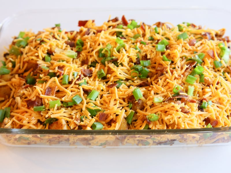 Buffalo Chicken and Potato Casserole - buffalo flavored chicken and potatoes topped with cheese, bacon, and onions. the-girl-who-ate-everything.com