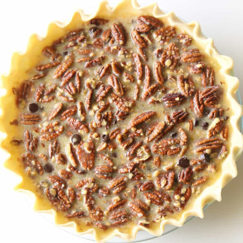 Chocolate Pecan Pie - inspired from the delicious pie from The Roaring Fork restaurant. This is a twist on the traditional pecan pie with chocolate chips and toffee bits inside. the-girl-who-ate-everything.com