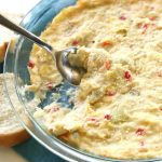 Warm Feta Dip With Artichokes - an easy and crowd pleasing appetizer with feta, artichokes, and pimentos.