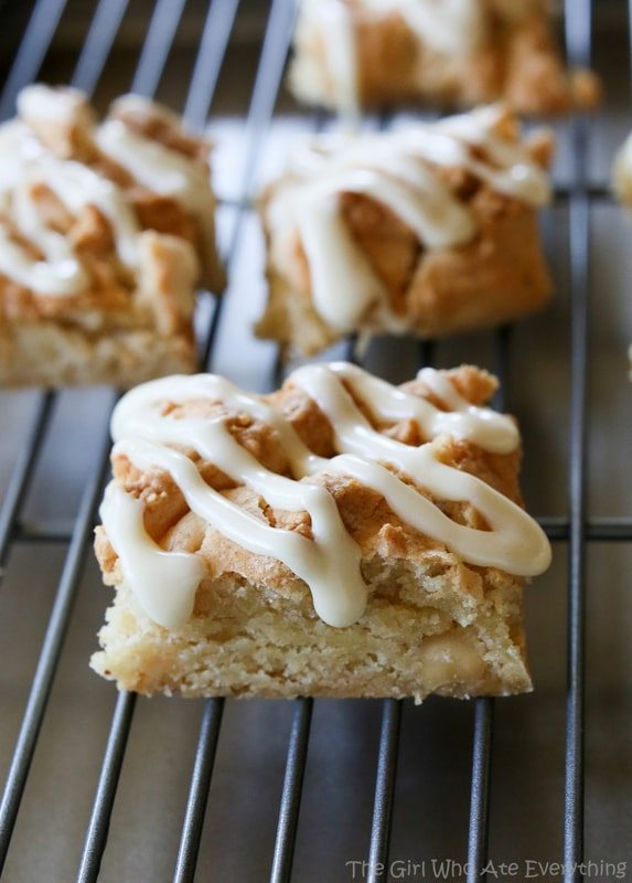 Nutty Eggnog Bars - Super chewy bars with macadamia nuts that are drizzled with an eggnog glaze. the-girl-who-ate-everything.com