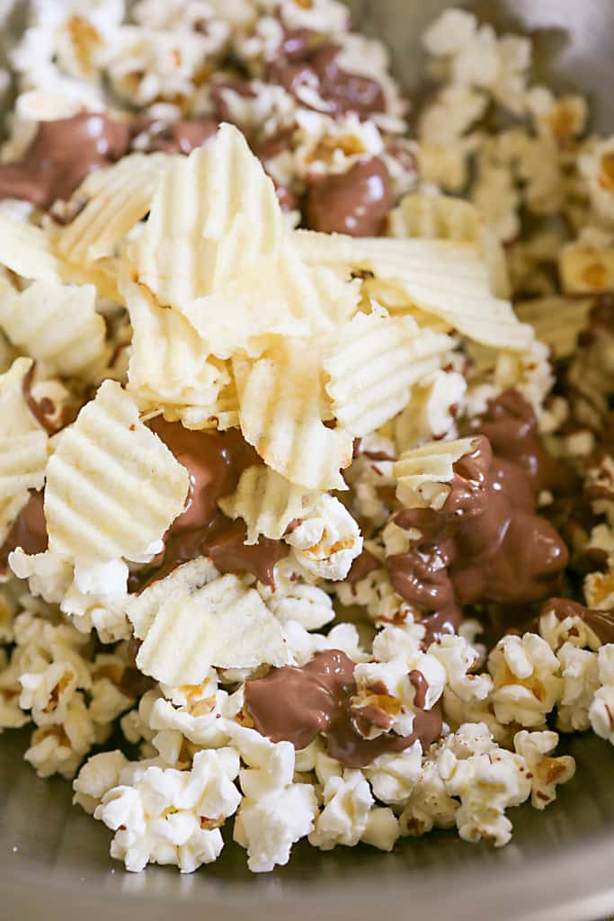 Chocolate-covered Potato Chip Popcorn - a sweet and salty treat that is so addicting. the-girl-who-ate-everything.com