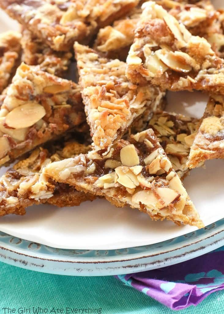 Caramel Heavenlies - layers of graham cracker, cinnamon, caramel, coconut, marshmallows, and almonds. the-girl-who-ate-everything.com