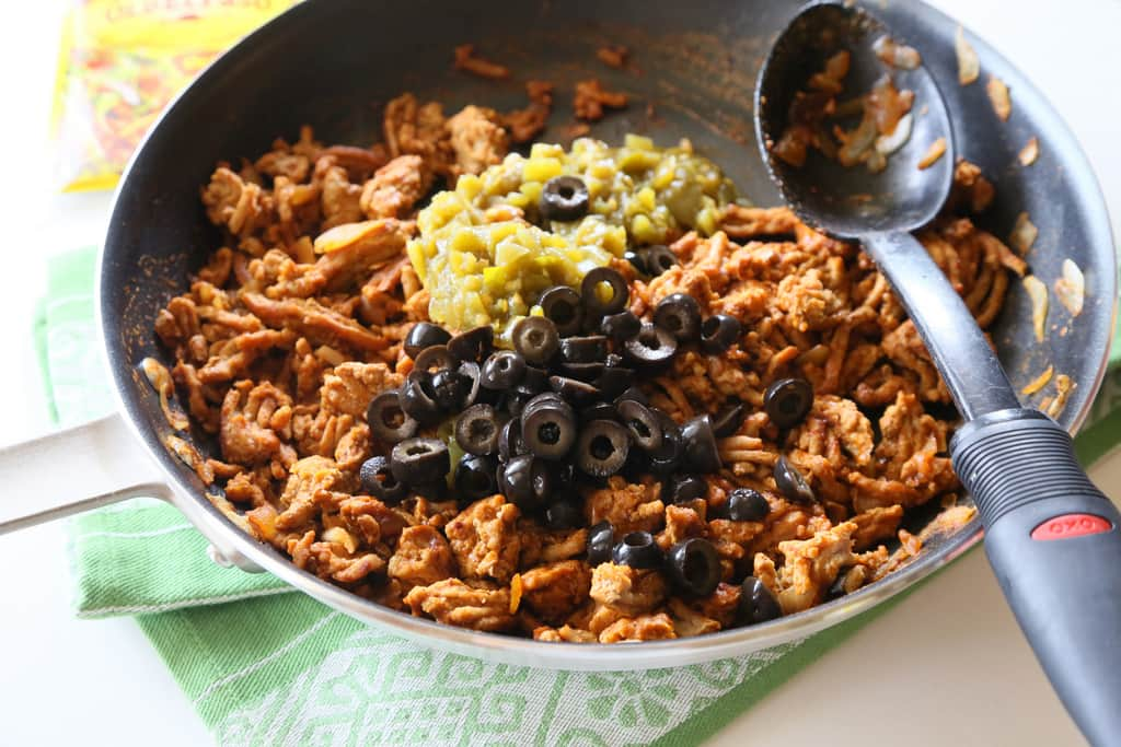 These Green Chile Turkey Tacos are packed with flavor and so easy. Green chilies and olives are added to the meat mixture. Even non-turkey lovers won't complain about these tasty tacos. the-girl-who-ate-everything.com
