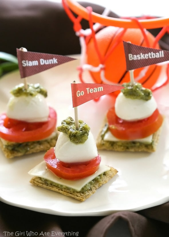 Caprese Triscuit Bites - A one bite appetizer perfect for the game. the-girl-who-ate-everything.com