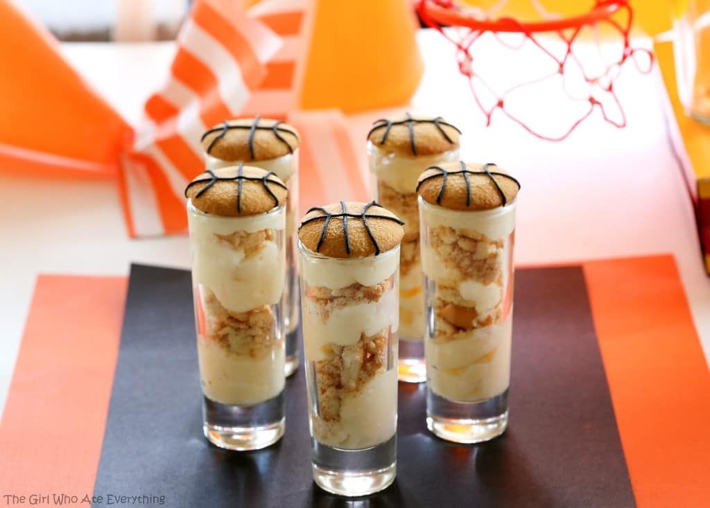 Cheesecake Pudding Shooters - layers of cheesecake pudding and crushed up Nilla wafers make for some easy March Madness treats. www.the-girl-who-ate-everything.com