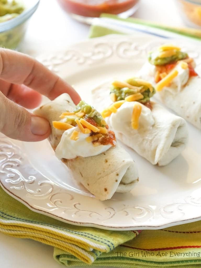 These Mini Burritos are filled with seasoned meat, beans, and cheese. Serve them as an appetizer and let your guests top their own. #burritos #mexican #appetizer