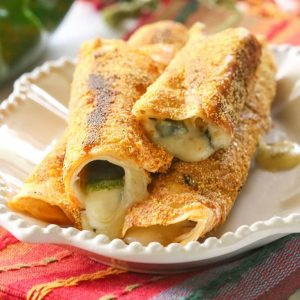 Chile Relleno Flautas - a poblano pepper and Monterey Jack cheese rolled up in a flour tortilla, sprinkled with seasoned cornmeal, and pan-fried until toasty. the-girl-who-ate-everything.com