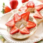 Strawberry Lemon Poppy Seed Bagel - a delicious and creamy almond poppy seed mixture is topped with sliced strawberries. the-girl-who-ate-everything.com