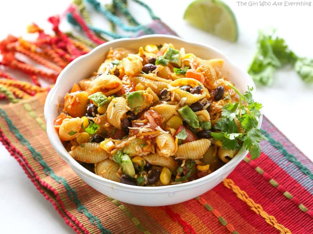 This Taco Pasta Salad is filled with black beans, corn, cilantro, avocados, and tomatoes. the-girl-who-ate-everything.com