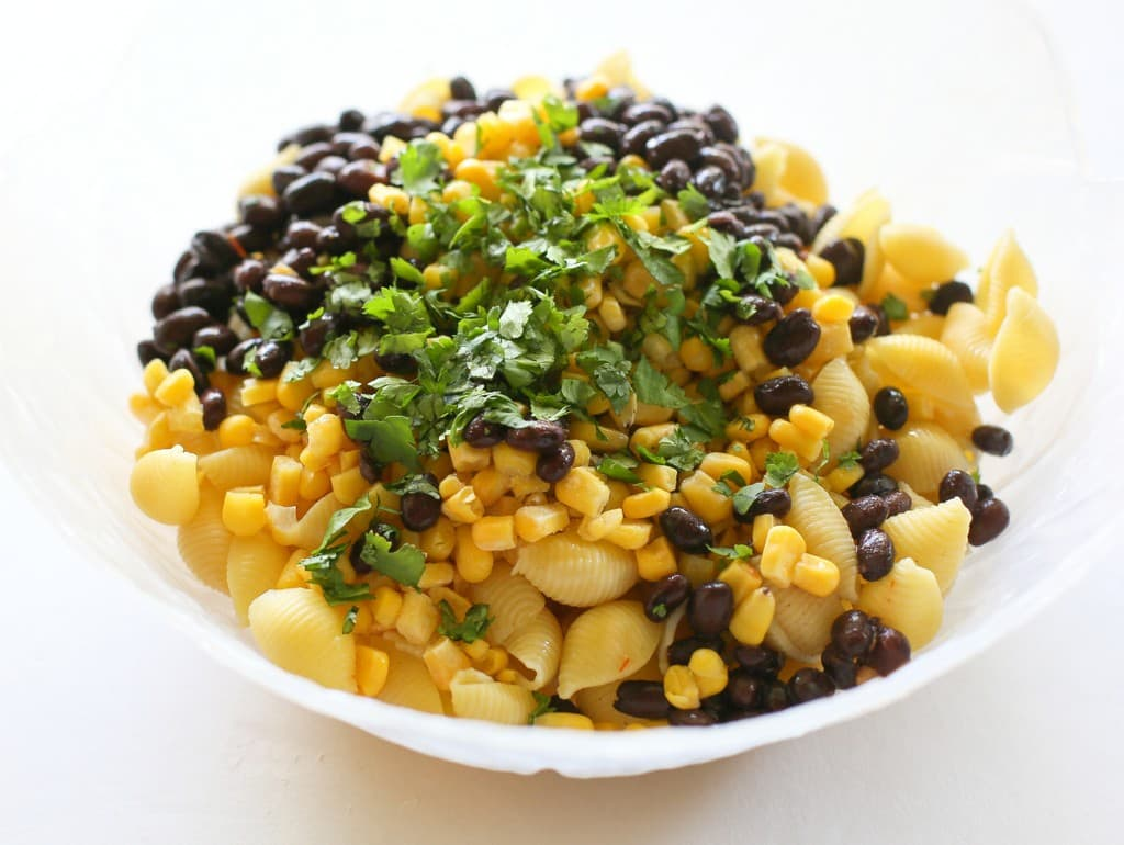 taco pasta salad ingredients in a bowl