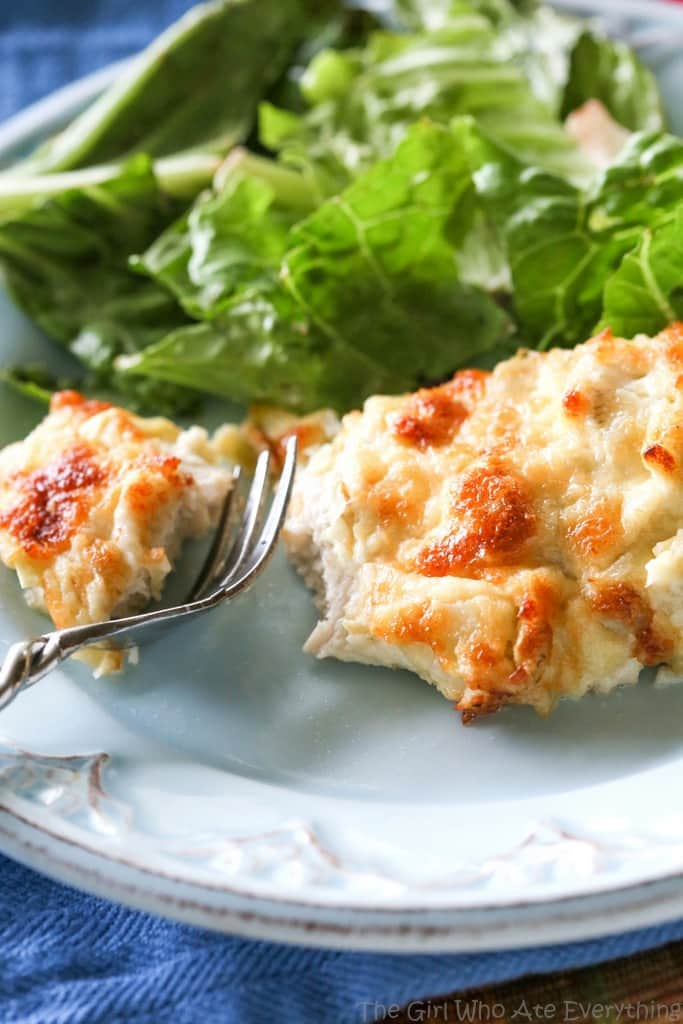 This Artichoke Chicken is a simple and easy meal that is delicious! It tastes like artichoke dip on top of chicken. the-girl-who-ate-everything.com