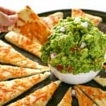 An Italian guacamole made with basil, garlic, avocado, red onions, and tomato. Instead of chips, super thin pizza crust strips are used. A knock-off from one of our favorite restaurant appetizers. the-girl-who-ate-everything.com