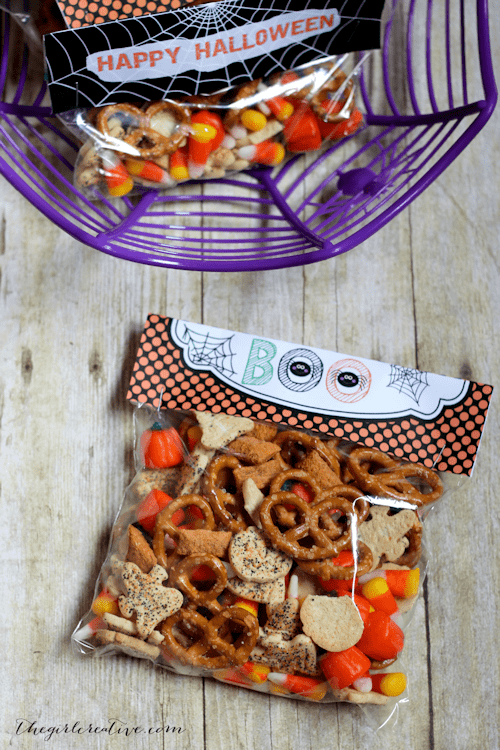 Halloween Party Mix is easy to prepare and it will leave your guests coming back for more. Includes free printable bag toppers that are sure to be a big hit at your Halloween party.
