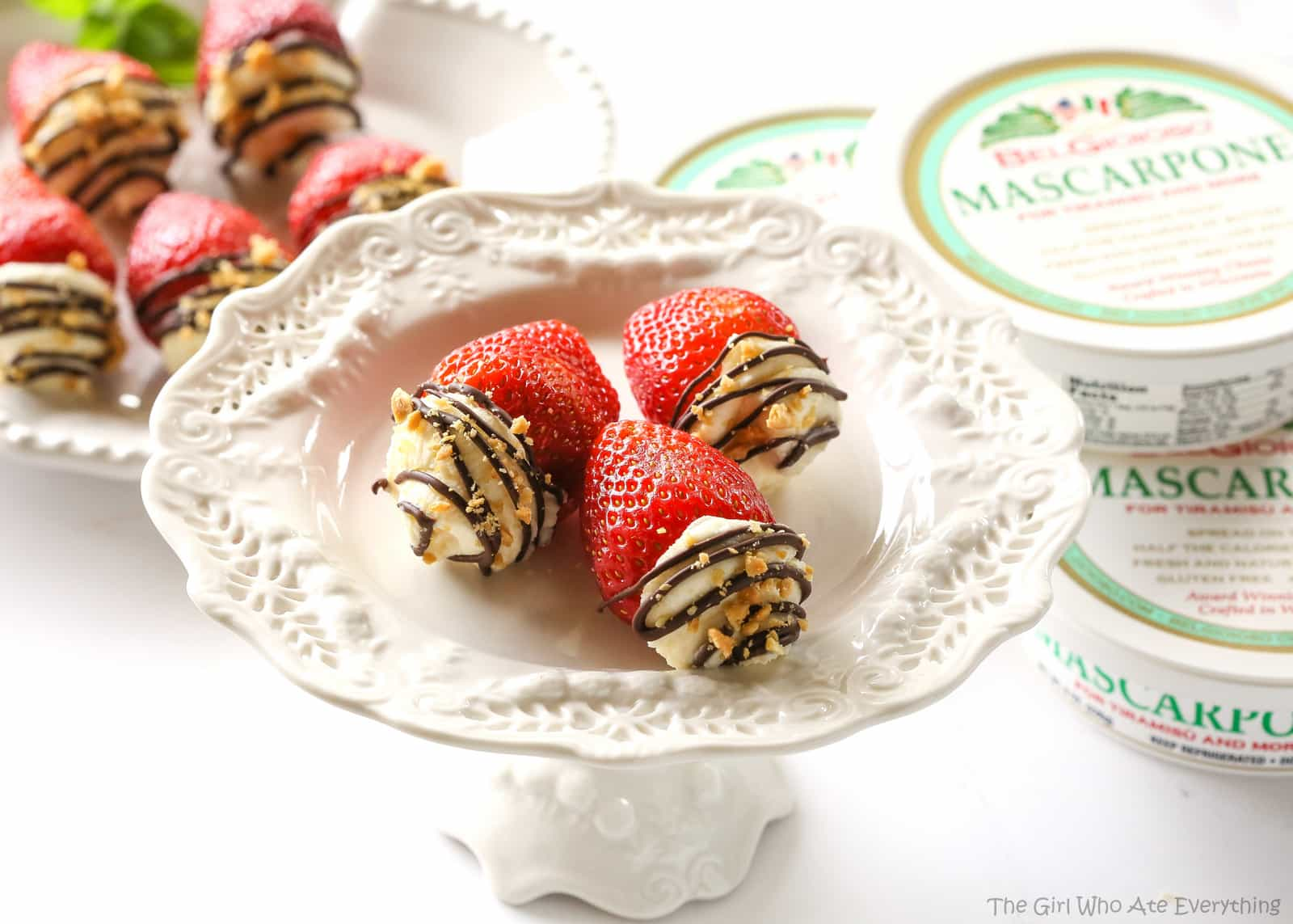 Mascarpone Stuffed Strawberrries. Sweet and silky mascarpone filled strawberries drizzled with chocolate and nuts. the-girl-who-ate-everything.com