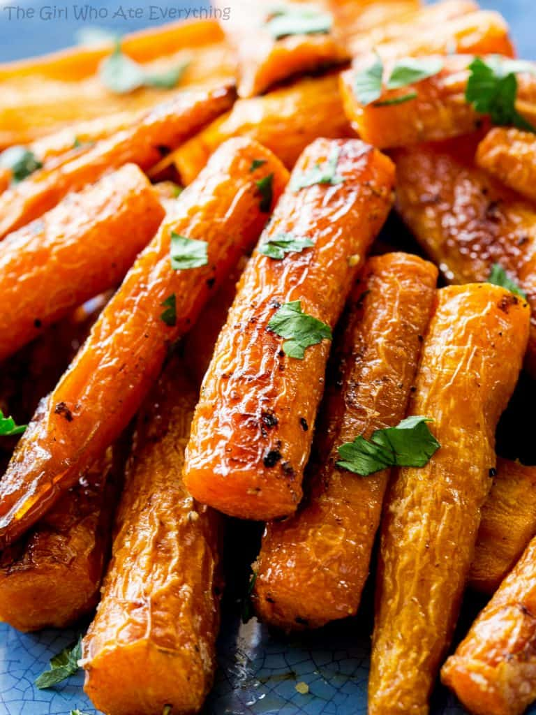 These Perfectly Roasted Carrots that have caramelized edges and are tender enough to eat without being mushy. This is a great side dish! the-girl-who-ate-everything.com