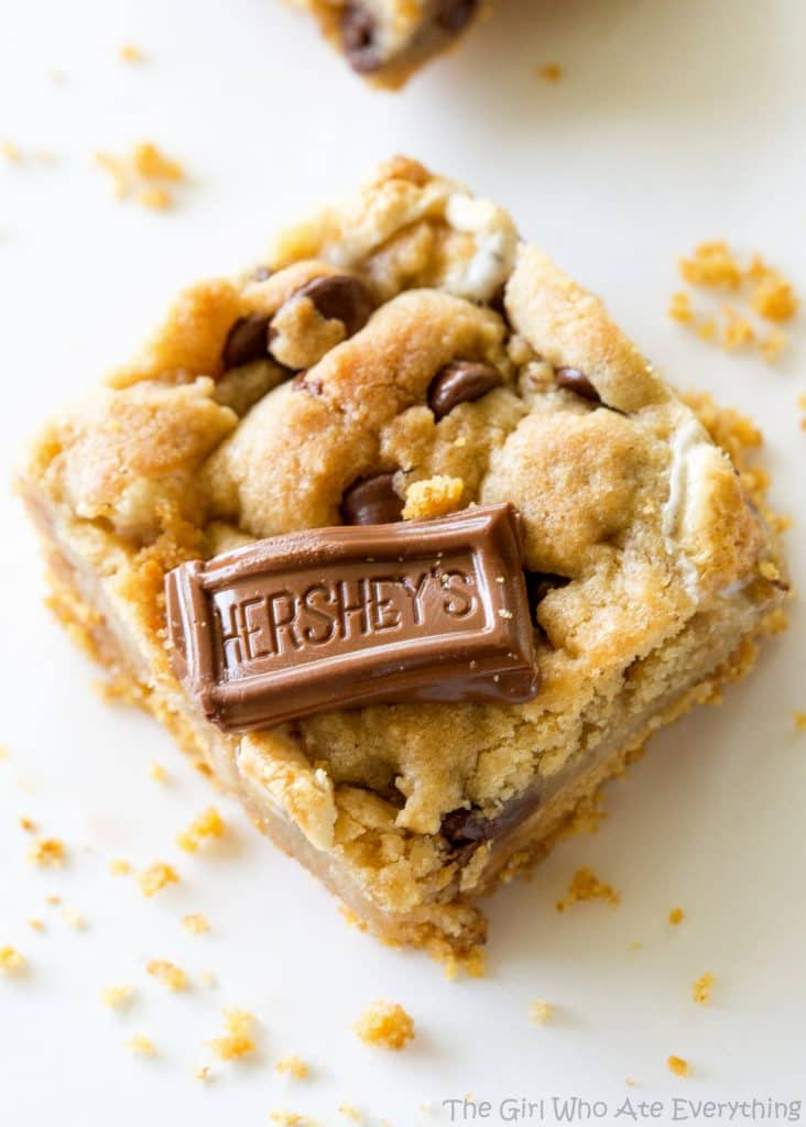 S'mores Cookie Bars - chocolate chip marshmallow cookie dough with a graham cracker crust. Seriously delicious. the-girl-who-ate-everything.com