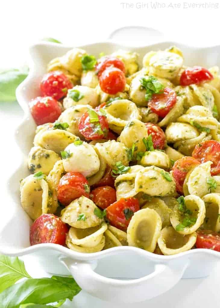 Caprese Pesto Pasta Salad in a white bowl