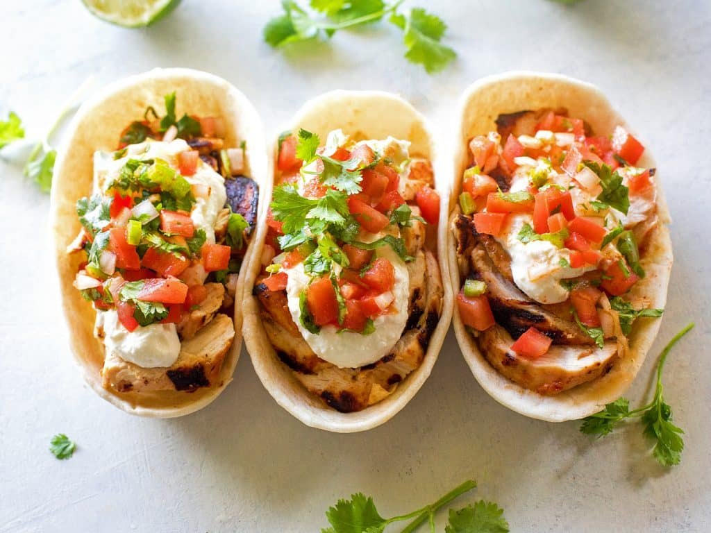 Grilled Chicken Tacos with Feta Cream - so much flavor in these that it's hard to eat just one! the-girl-who-ate-everything.com