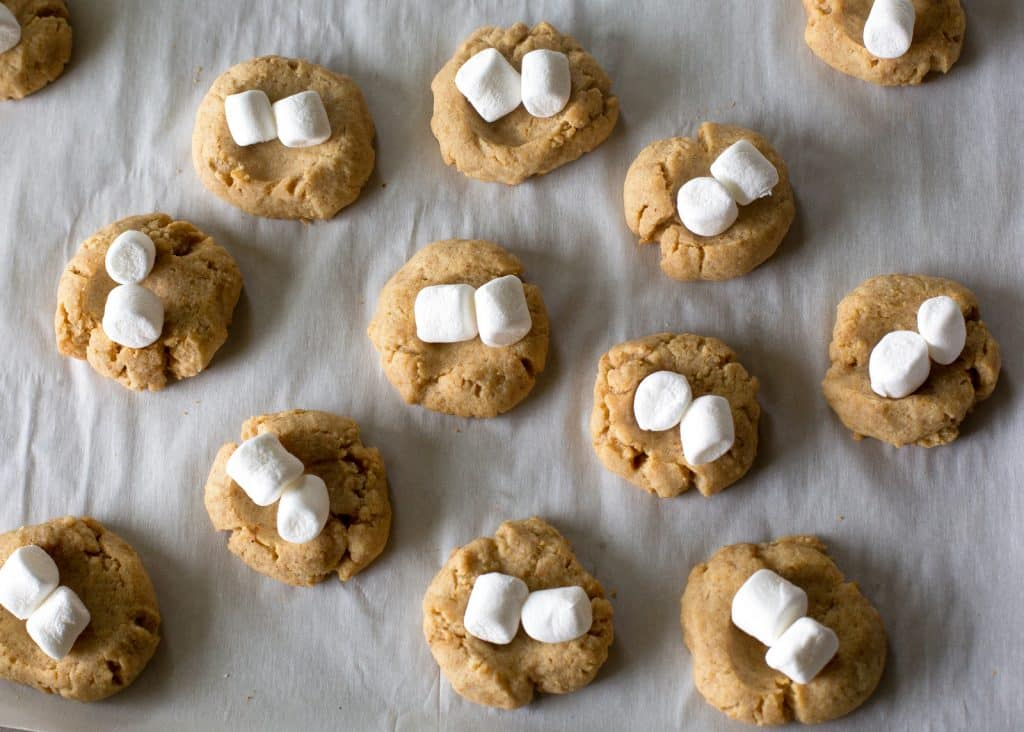 S'mores Thumbprints - a small graham cracker cookie topped with marshmallows and chocolate. the-girl-who-ate-everything.com
