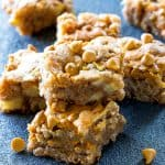 Apple Snack Squares - a dense apple and walnut square that is topped with butterscotch chips. the-girl-who-ate-everything.com