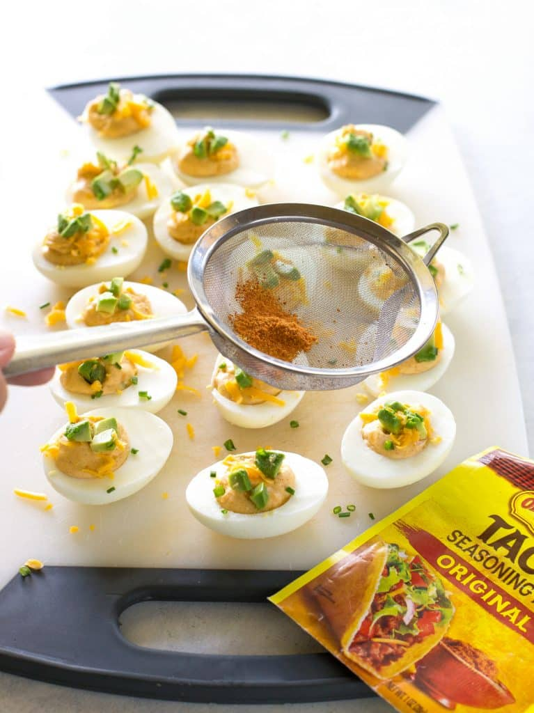 These Mexican Deviled Eggs are a spicy twist on your classic deviled eggs. the-girl-who-ate-everything.com