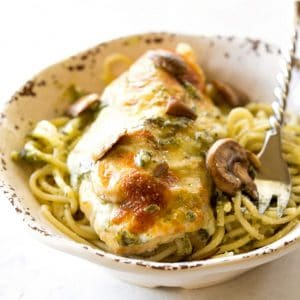 Pesto Chicken - you'll never believe how easy this delicious dinner is! the-girl-who-ate-everything.com