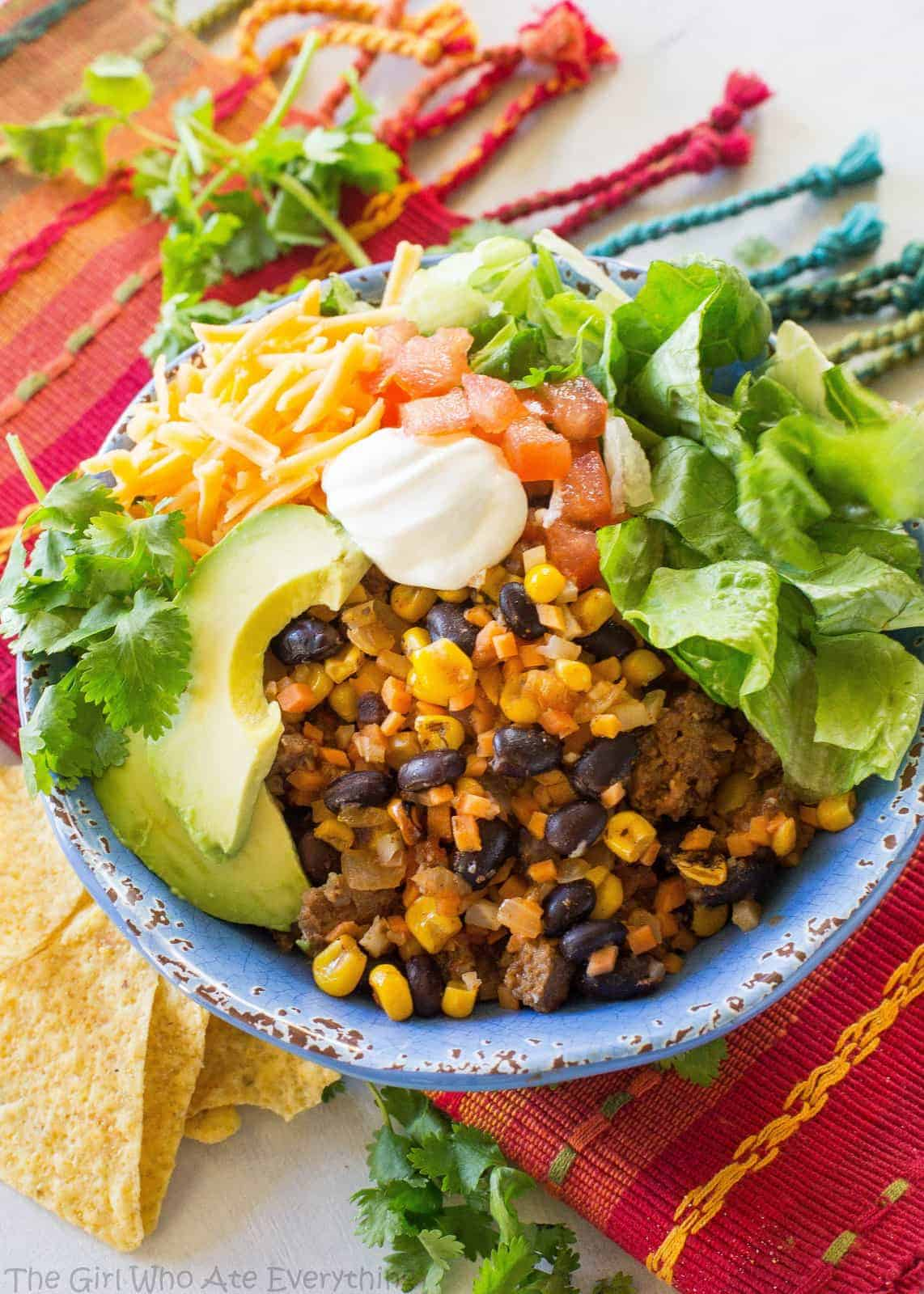 Riced Cauliflower and Sweet Potato Beef Burrito Bowls - a healthy version of your favorite burrito bowl! the-girl-who-ate-everything.com