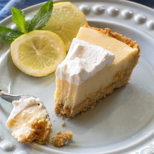 Magnolia's Lemon Pie - light, sweet and tart lemon pie with a thick graham cracker crust. From Joanna Gaines! the-girl-who-ate-everything.com