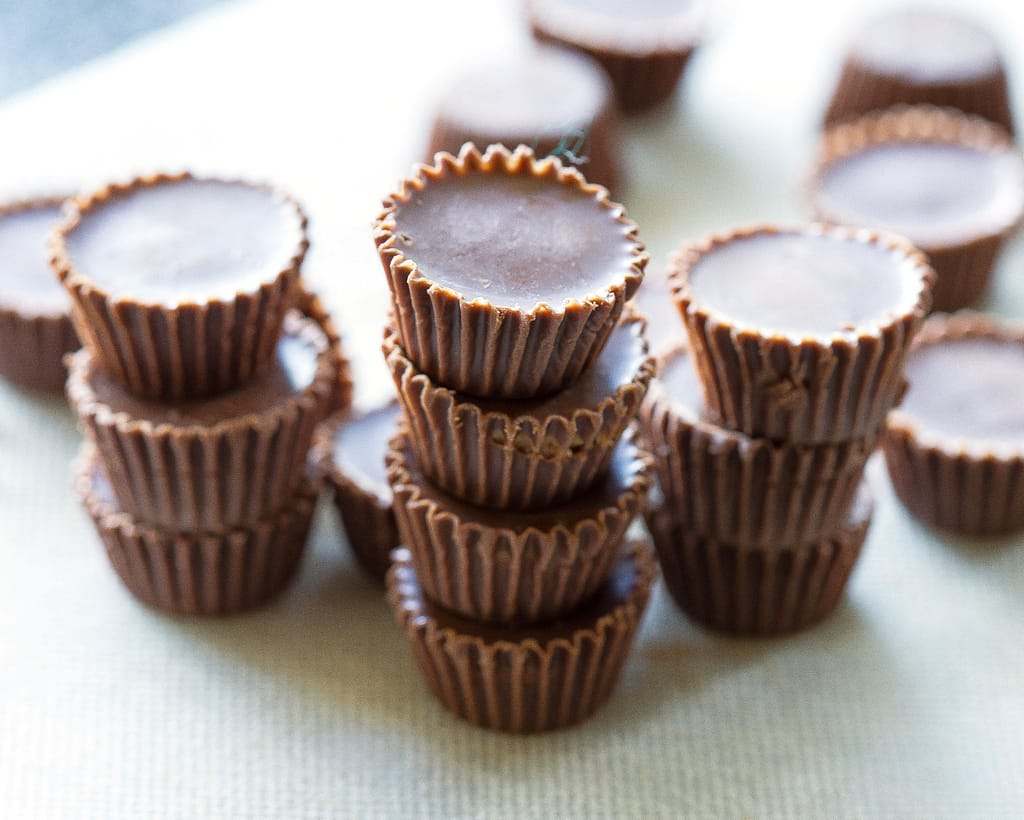 Reese's Peanut Butter Cupcakes - stuffed with Reese's Peanut Butter Cups and topped with a peanut butter frosting. the-girl-who-ate-everything.com