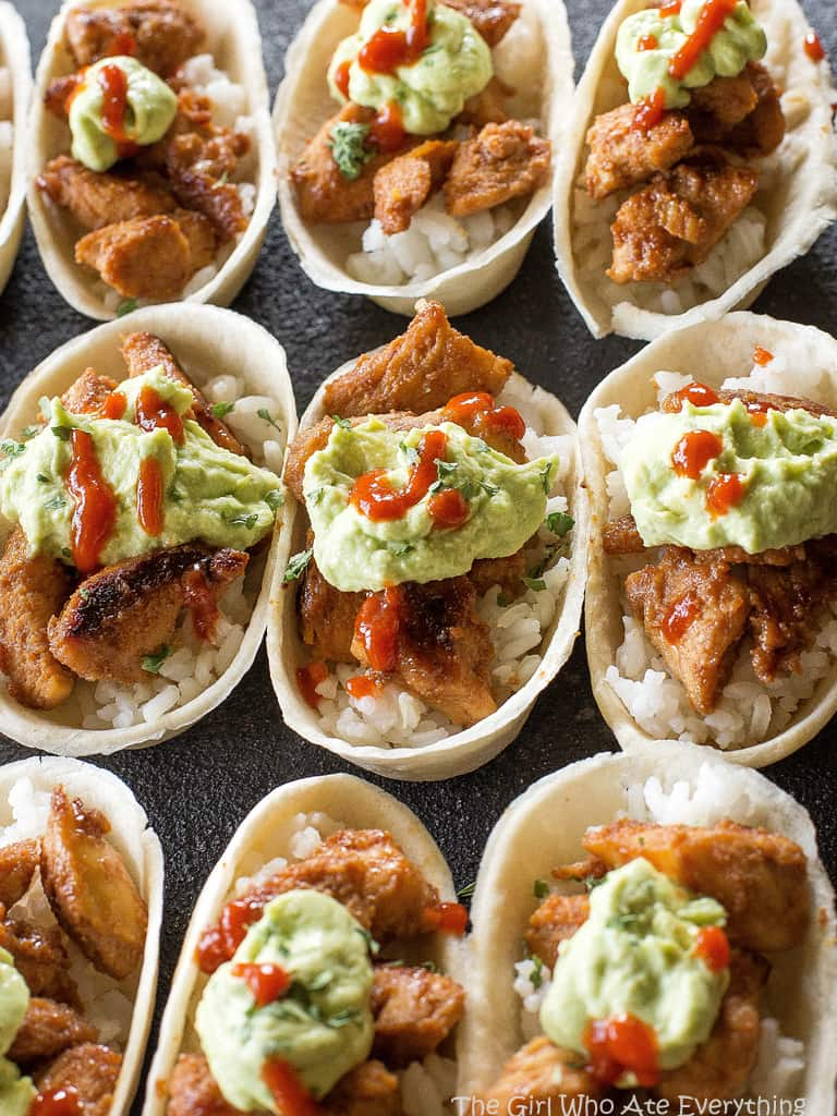 Mini Honey Sriracha Chicken Taco Boats - spicy and sweet chicken tacos topped with an avocado crema. the-girl-who-ate-everything.com